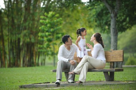 Photo for Happy Asian Family enjoying their time in the park - Royalty Free Image