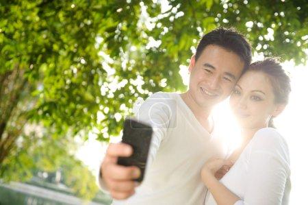 Asian Couple Taking Photographs