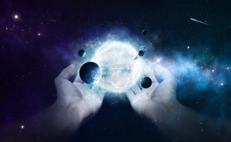 Photo for Two hands holding the sun and planets in the universe - Royalty Free Image