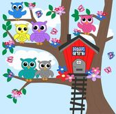 Colorful owls sitting in a tree