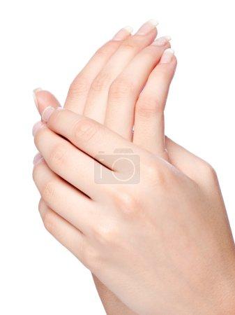 Photo pour Mains de femme avec manucure française, isolées sur blanc - image libre de droit