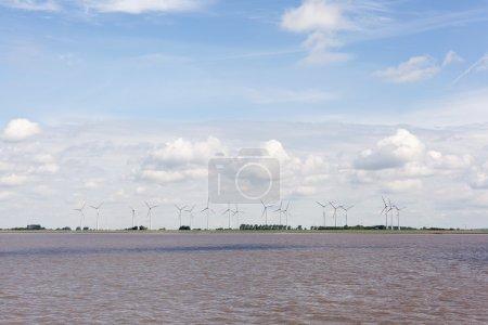 Wind turbines near river