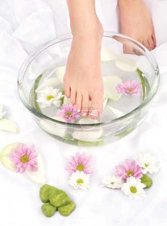 Photo for Feet dipped in aromatherapy bowl - Royalty Free Image