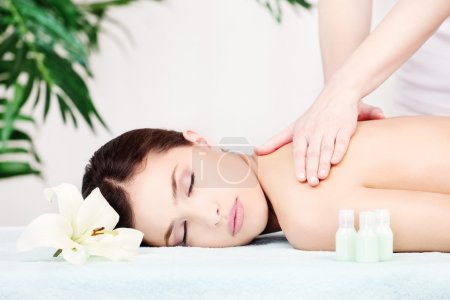 Photo for Pretty woman on shoulder massage in salon - Royalty Free Image