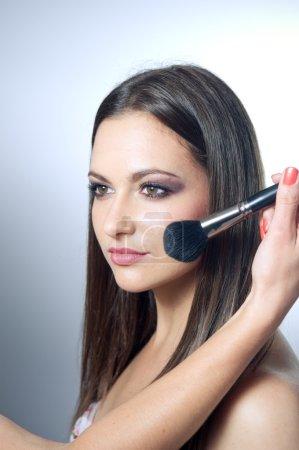 Hand applying make up