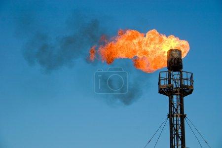 Burning oil flare
