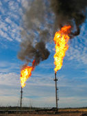 Burning oil gas flares