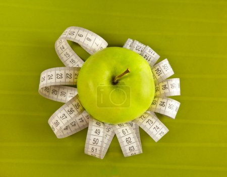 Picture of apple and tape measure