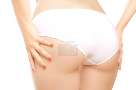 Photo for Woman's button in white panties isolated on white - Royalty Free Image