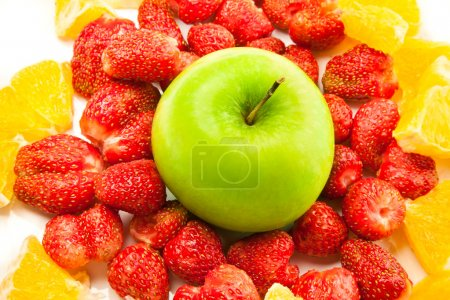 Photo for Green apple, strawberry and orange on the plate - Royalty Free Image