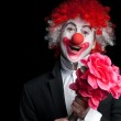 Colorful clown with flowers on a black background...