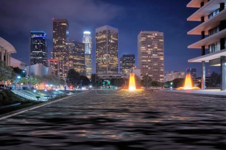 Photo for The skyline of Los Angeles after dark, with fountains. - Royalty Free Image