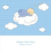 Baby boy sleeping on the cloud