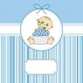 Baby boy with a birthday cake. greeting card
