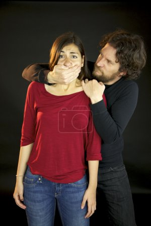 Man holding womans mouth violence