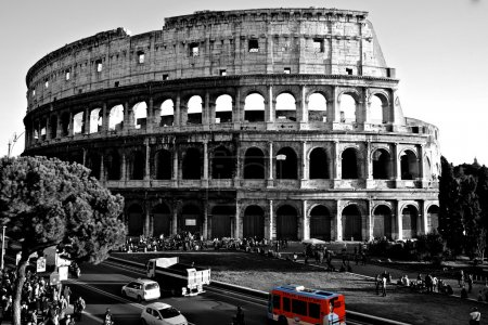 Colosseum with a red bus