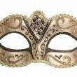 Carnival mask decorated with designs on a white ba...