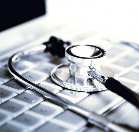 Photo for Technology and medicine - Silver stethoscope over laptop keyboard - Royalty Free Image
