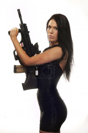 Woman looking holding gun