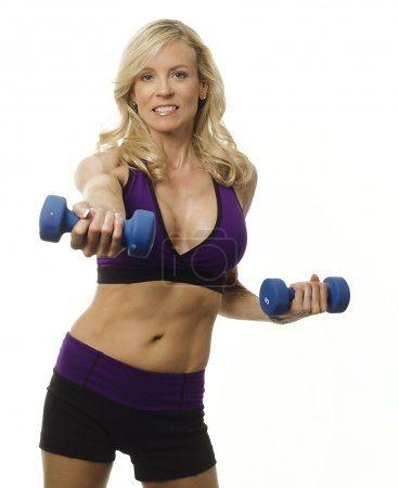 Attractive woman working out with dumbells