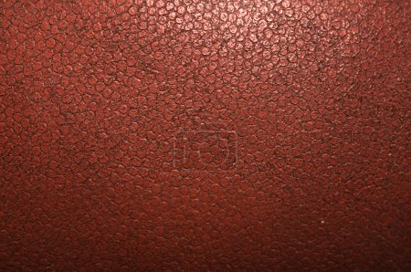 Close up detail of texture of an american football.