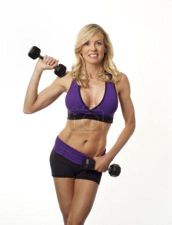 Healthy beautiful mature woman exercising