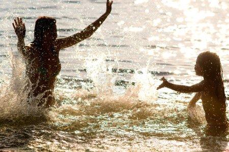 Family splashes in water