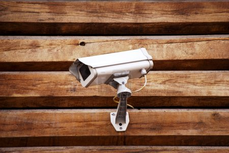 Camera on a wall of wooden houses
