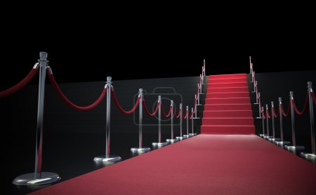 Photo for Red carpet leading up to stairs with a raw of stanchions - Royalty Free Image