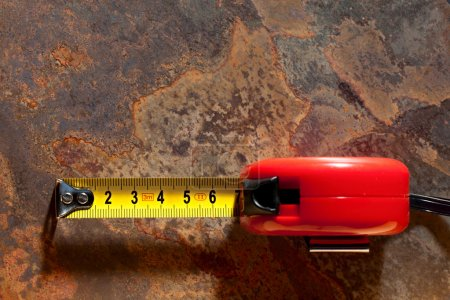 Photo for Tape measure on the rusty background - Royalty Free Image
