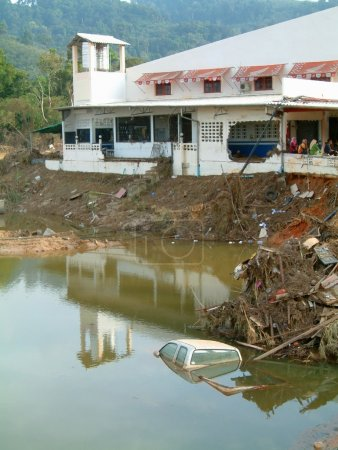 Submerged pickup truck in water hole after tsunami, khao lak, thailand