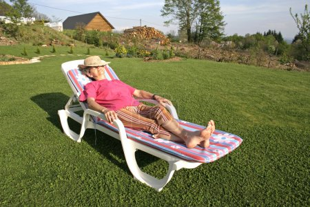 Woman pensioner enjoying her free time in garden