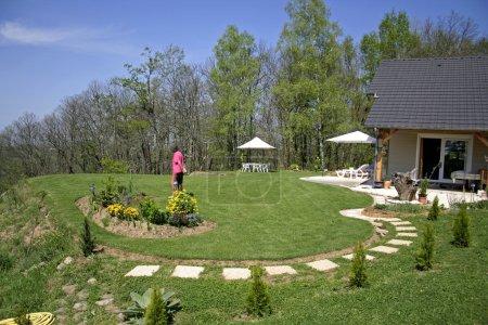 Lady walking in landscaped garden