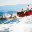 Group of four bouncing up over wake on tubes on Cr...