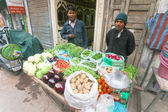 Men with vegetable stall