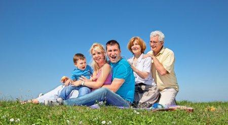 Happy family on picnic in park