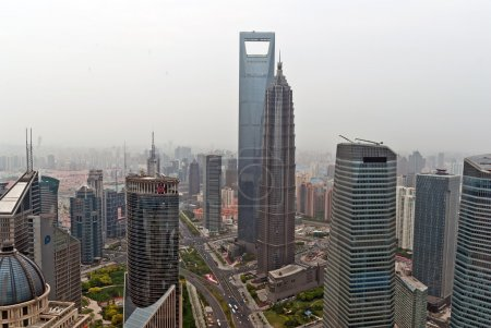Shanghai World Financial Center and Jin Mao Tower.