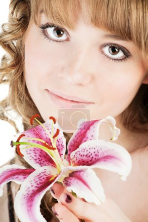 Portrait of fresh woman with flower over white