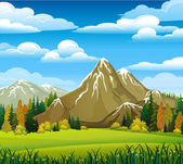 Autumn landscape with meadow forest and mountains on a cloudy sky background