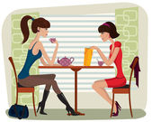 Two beautiful women in cafe