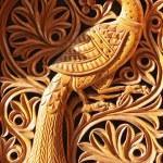 Wood carving, the mythological bird on the abstrac...