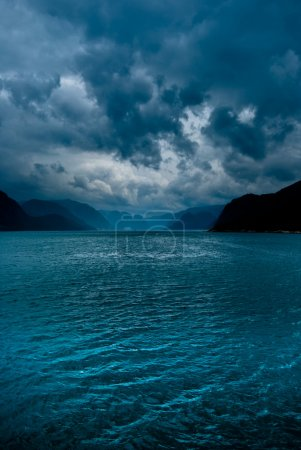 Photo for Fjord with dark clouds in norway - Royalty Free Image