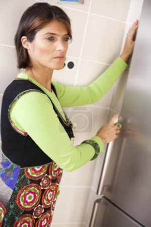 Woman opening her refrigerator