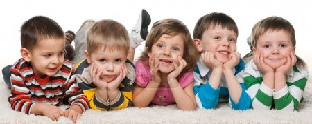 Photo for A little girl is lying at four little boys on the carpet - Royalty Free Image
