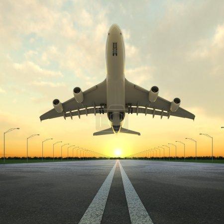 Photo pour Avion au décollage vu du bas de la piste d'atterrissage de l'aéroport au coucher du soleil . - image libre de droit