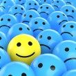 A yellow happy smiley between many blue sad others...
