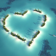 Aerial view of heart shaped island with yacht as c...