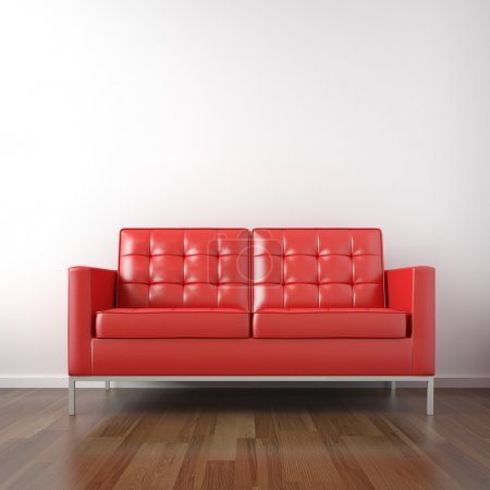 Red couch in white room