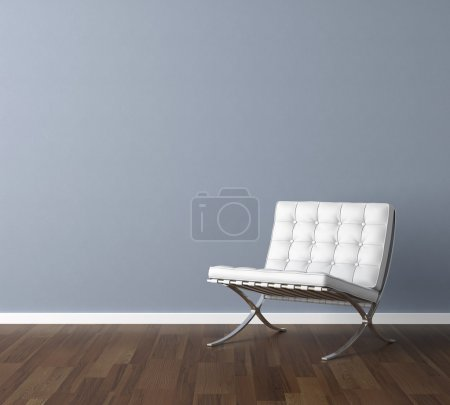 Blue wall with white chair interior design