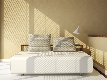Sofa-bed on tan wall